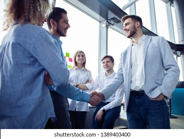 Business partnership meeting concept. Businessmen handshake. Successful businessmen handshaking after good deal