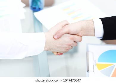 Business partnership meeting concept. Image businessmans handshake. Successful businessmen handshaking after good deal. Horizontal, blurred background