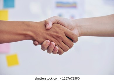 Business partnership meeting concept. Image businessman handshake. Successful businessmen handshaking after good deal. Horizontal, blurred background.Split tone instagram like process.
