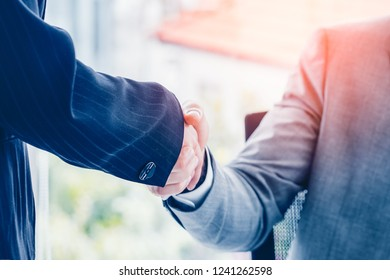 Business partnership meeting concept. Image of businessman  handshake. Successful businesspeople handshaking after good deal. Horizontal, blurred background.