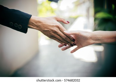 Business partnership meeting concept. Image business people handshake. Successful business people handshaking after good deal. Horizontal.