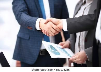 Business partnership meeting concept. Image businessmans handshake. Successful businessmen handshaking after good deal. Horizont