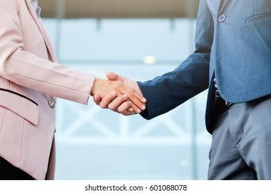 Business partnership meeting concept. Image businessmans handshake. Successful business peolple handshaking after good deal.