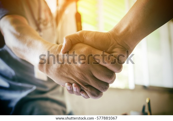 Business partnership meeting concept. Image businessman handshake. Successful businessmen handshaking after good deal. Horizontal, blurred background
