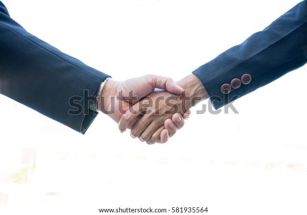 Business partnership meeting concept. Image business man handshake. Successful businessmen handshaking after good deal. Horizontal, blurred background