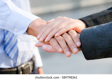 Business partnership meeting concept. Successful businessmen handshaking ,Image of businesspeople hands on top of each other as symbol of their partnership, Hands in color filter.