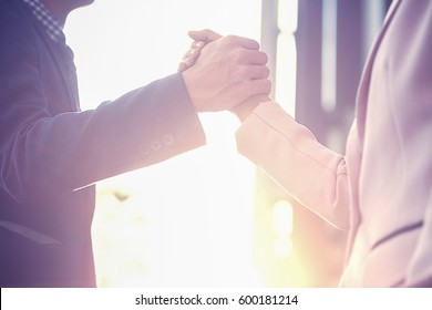 Business partnership meeting concept. Successful business handshaking after good deal. Horizontal blurred background (selective focus).
