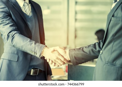 Business partnership meeting concept.Image of businessmen handshake. Successful businessmen handshaking after good deal. Horizontal, blurred background.Congratulation, merger and acquisition concepts.