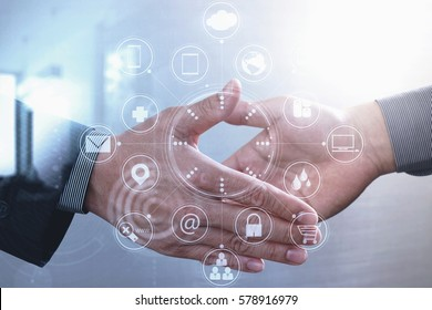 Business partnership meeting concept.photo businessman handshake. Successful businessmen handshaking after perfect deal.close up,virtual graph chart interface screen
