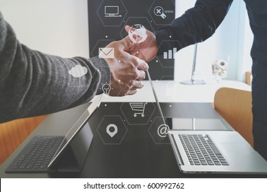 Business partnership meeting concept.photo businessman handshake. Successful businessmen handshaking after perfect deal with virtual graph chart diagram