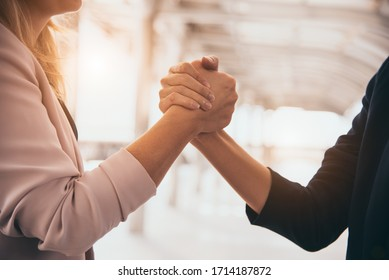 Business partnership meeting trust handshaking concept. Businesswomen doing arm wrestling. Successful business people contract promise for good confidence dealing with skyscraper building background