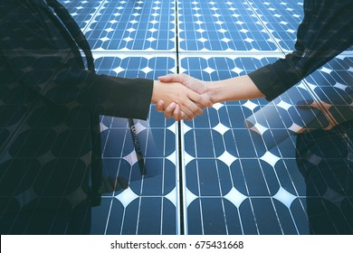 Business, Partnership,Cooperation and gesture concept - businesswoman and architecture shaking hands over Solar energy panel photovoltaics module double exposure background