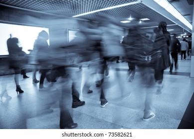 Business passenger walk at subway station at intentional motion blurred