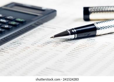 business pen, calculator on financial chart, business concept