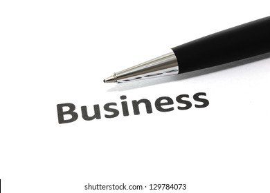 Business with pen isolated close-up