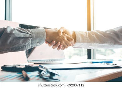 Business people accept or confirm project on the proposal and join shaking hands at office room company.