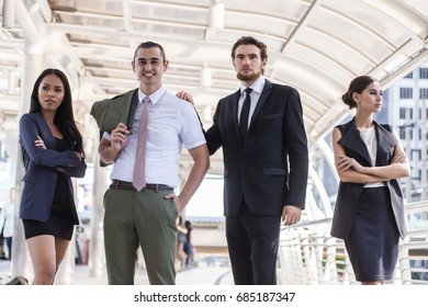 Business, People, Advertisement concept - Group of happy and positive business people outside office. Business team success and winner.