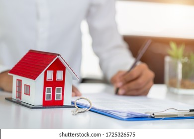 Business people or agents are signing contracts Businessmen or home agents are giving away house keys and house keys to home customers and home insurance. Real Estate and Mortgages.