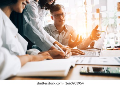 Business people analyzing investment graph meeting brainstorming and discussing plan in meeting room, investment concept