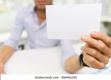 business, people, announcement and advertisement concept - close up of businessman showing blank paper card at office