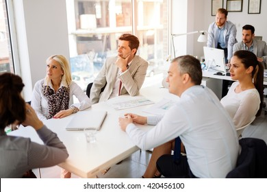 Business people and architects discussing future plans
