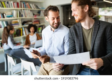 Business people, architects having discussion and working in office