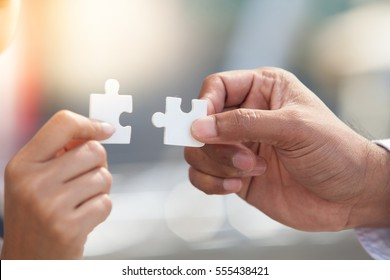 business people assembling jigsaw puzzle and represent partner team support and help concept.partner team business concept