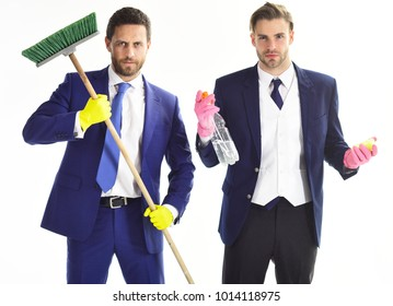 Business people with beards and mop. Bearded friends in formal suits with serious faces and sweep. Housework, cleaning business, teamwork, support concept. Banker and financier hold cleaning supplies.