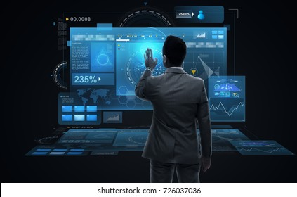 business, people, big data and technology concept - businessman working with virtual reality screens from back over black background