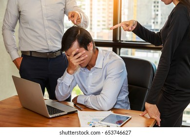 Business people blaming frustrated male colleague in Office. Negative human emotions concept