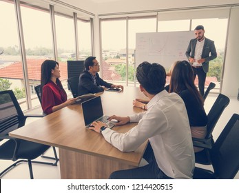 business people in board room,Businessman explaining new business ideas