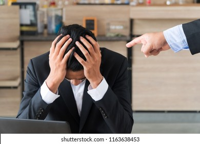 Business people the boss, point fingers, blame. Young businessmen holding the head stress being boss blame.  Concept of accused businessman with fingers pointing.