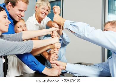Business people building tower with their fists in a teamwork effort