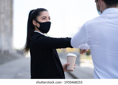 Business people bumping elbows for greeting each other.