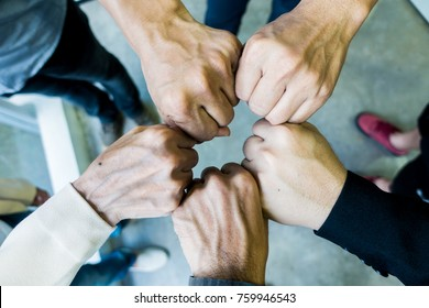 Business people bumping hands together for business success. Team work.