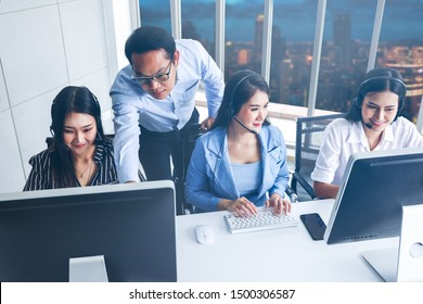 Business people or call center office are working with using headphone set and computer for talking and answer and consulting, manager teaching or suggestion