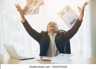 business people celebrating happy winner throwing papers on office desk business district , business success concept