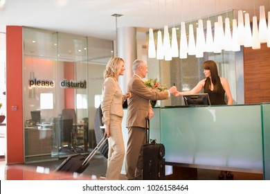 Business people checking into hotel