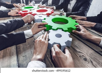 Business people with cogs of business, modern business meeting concept