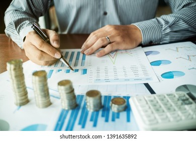 business people with coin stack and data spreadsheets, Investment concept.
