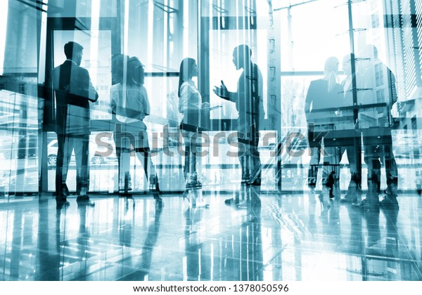 Business people collaborate together in office. Double exposure effects. Corporation, corporate.