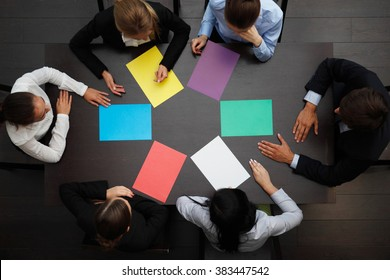 business people with colored paper concept