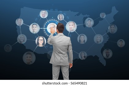 business, people, communication, cooperation and technology concept - businessman touching virtual screen with contacts icons and usa or america map over dark blue on background
