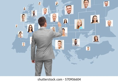 business, people, communication, cooperation and technology concept - businessman with marker at virtual screen with contacts icons and europe map over blue background