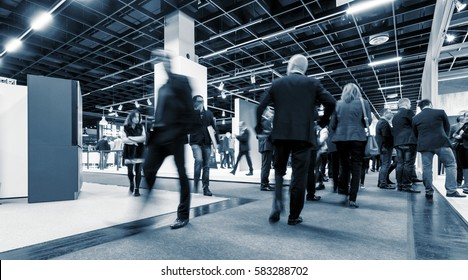 Business People Commuter Walking at Rush Hour on a trade fair