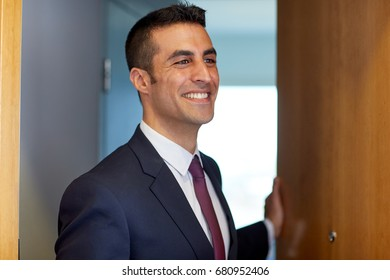 business and people concept - businessman at hotel room or office door