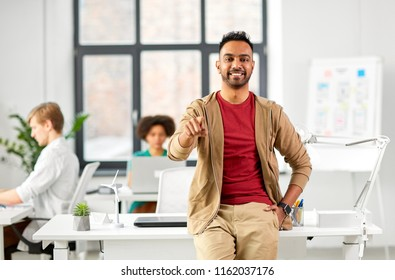 business and people concept - happy smiling creative indian man at office pointing finger at you