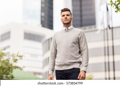 business and people concept - young man on city street