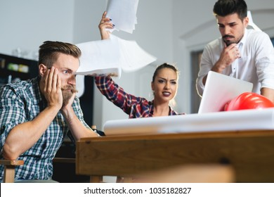 Business people conflict problem, team working throw papers, documents fly in air