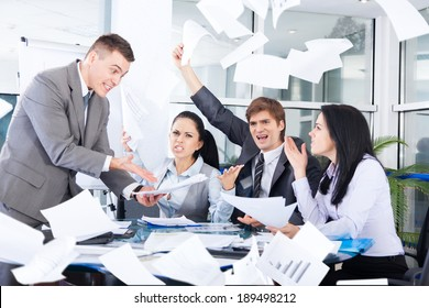 business people conflict problem, team working throw papers, documents fly in air,, businessmen and women serious argument negative emotion, businesspeople meeting at desk office